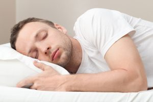A man lying in bed asleep