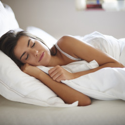 An image of a woman laying in bed